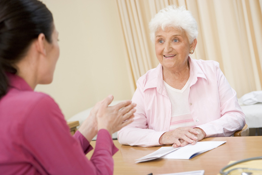 Woman in doctor's office smiling and discussing urological condition