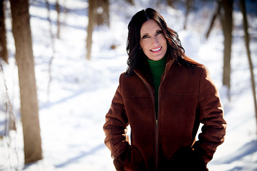 Happy healthy woman in snow